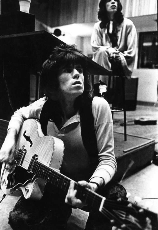 "Guitarist Keith Richards and singer Mick Jagger of the rock band ""the Rolling Stones"" record in a studio in june of 1969. Keith is playing a hollow body electric guitar. Photo: Michael Ochs Archives, Getty Images / Michael Ochs Archives"