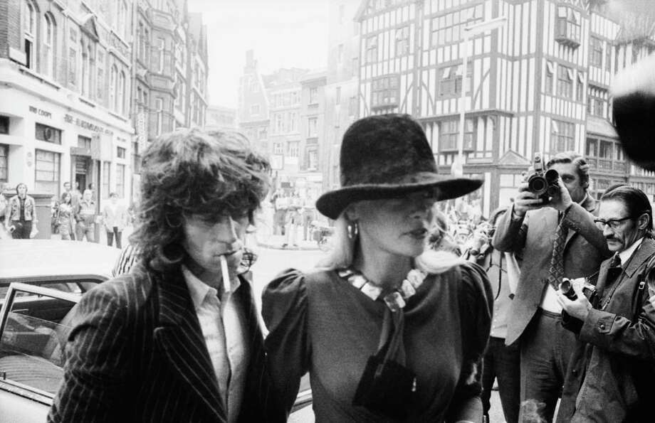 Guitarist Keith Richards of the Rolling Stones arrives at Marlborough Street Court, London with girlfriend Anita Pallenberg, 27th June 1973. The pair are charged with possession of cannabis. Richards is also charged with firearms offences. Photo: Frank Barratt, Getty Images / 2006 Getty Images