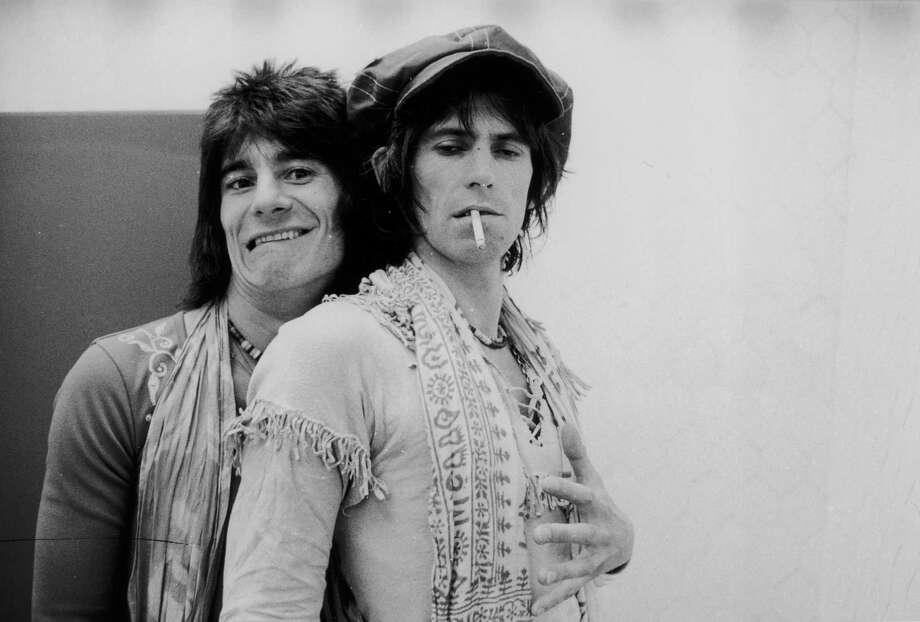 Jovial guitarist Ron Wood (left) embraces his elegantly wasted colleague Keith Richards backstage during the Rolling Stones' 1975 Tour of the Americas. Photo: Christopher Simon Sykes, Getty Images / 2004 Getty Images