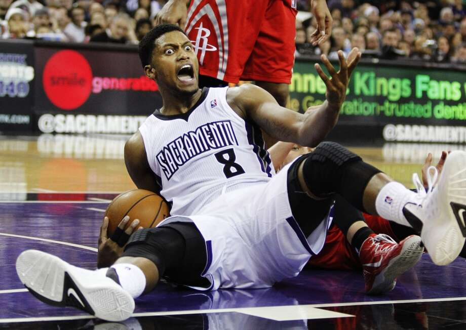 Kings forward Rudy Gay (8) reacts after being called for a loose ball foul against the Rockets. Photo: GENEVIEVE ROSS, Associated Press