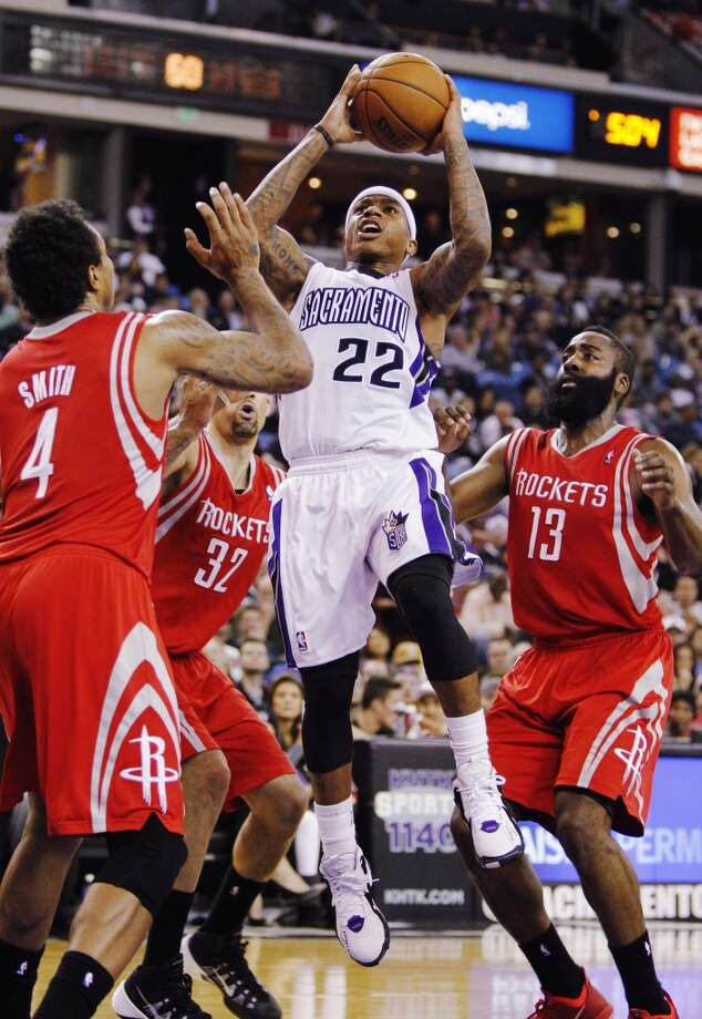 Kings point guard Isaiah Thomas (22) scores against Rockets forward Greg Smith (4), Rockets guard Francisco Garcia (32) and Rockets guard James Harden. Photo: GENEVIEVE ROSS, Associated Press