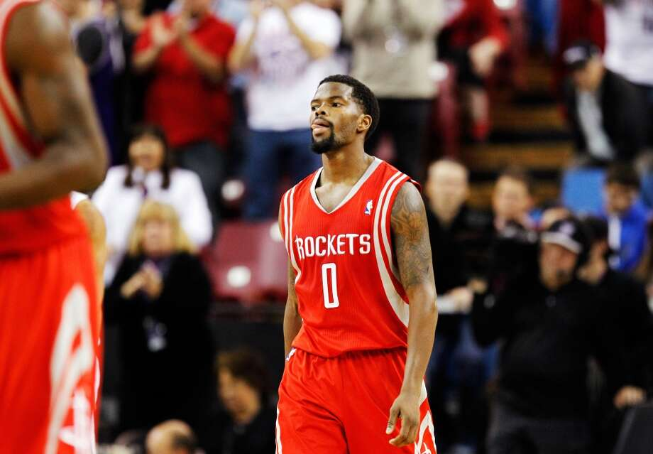 Rockets point guard Aaron Brooks walks off the court as the clock expires. Photo: Genevieve Ross, Associated Press