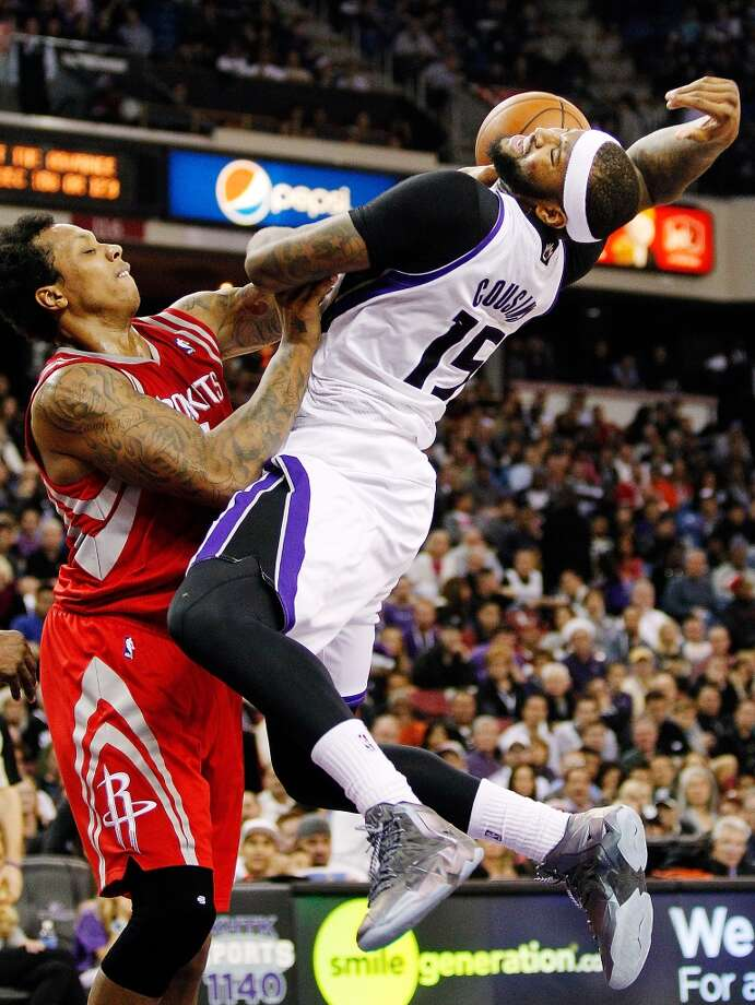 Kings center DeMarcus Cousins (15) is fouled by Rockets forward Greg Smith. Photo: GENEVIEVE ROSS, Associated Press