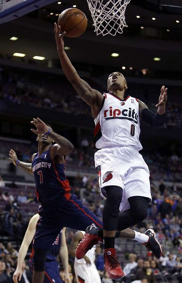 Portland guard Damian Lillard blows past Brandon Jennings on his way to 23 points against the Pistons. Photo: Duane Burleson, Associated Press