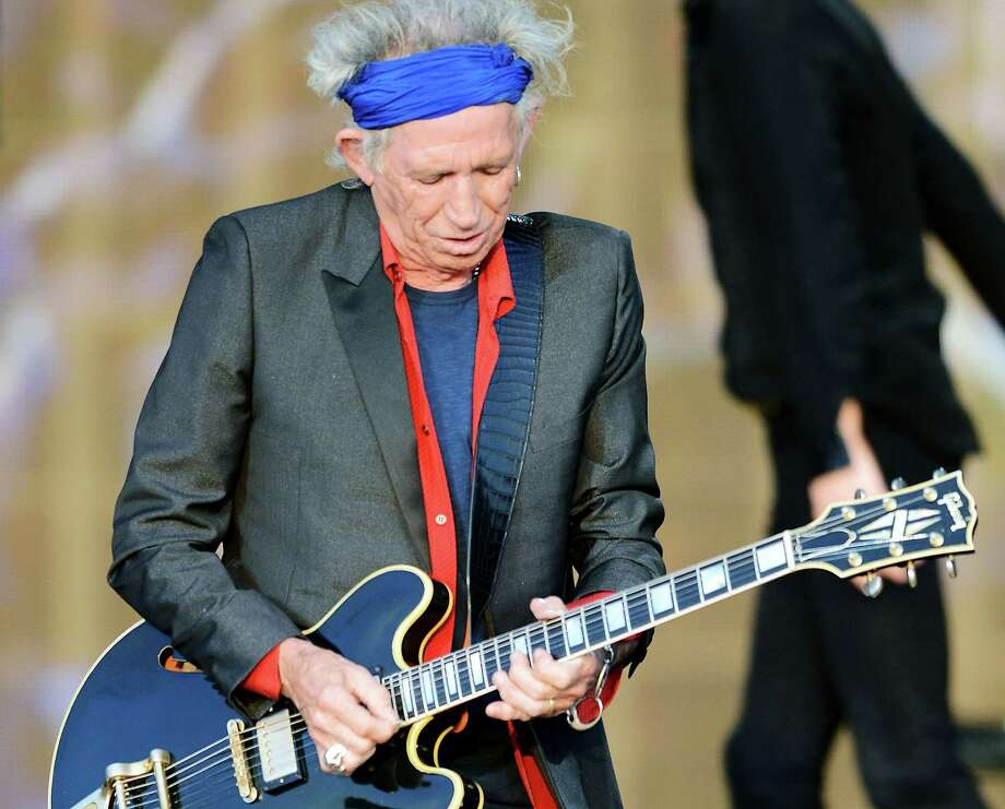 Keith Richards of The Rolling Stones performs on stage during a headline performance as part of Barclaycard Present British Summer Time Hyde Park on July 13, 2013 in London, England. Photo: Dave J Hogan, Getty Images / 2013 Getty Images