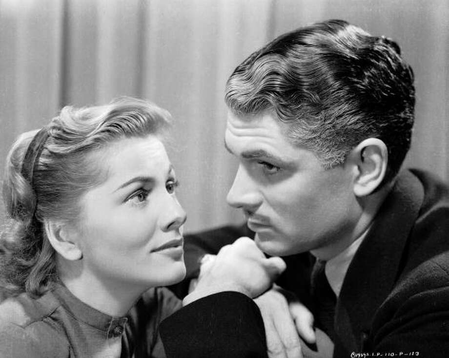 1940:  Laurence Olivier and Joan Fontaine playing Max and Mrs de Winter in Hitchcock's classic 'Rebecca'.  (Photo via John Kobal Foundation/Getty Images) Photo: John Kobal Foundation, Getty Images / Moviepix