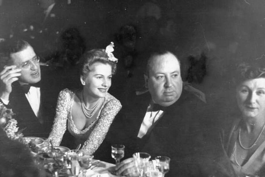 Producer David O. Selznick, actress Joan Fontaine, & dir. Alfred Hitchcock & wife at Academy Award presentation dinner which honored their movie Rebecca as best of the year..  (Photo by Peter Stackpole//Time Life Pictures/Getty Images) Photo: Peter Stackpole, Time & Life Pictures/Getty Image / Time Life Pictures
