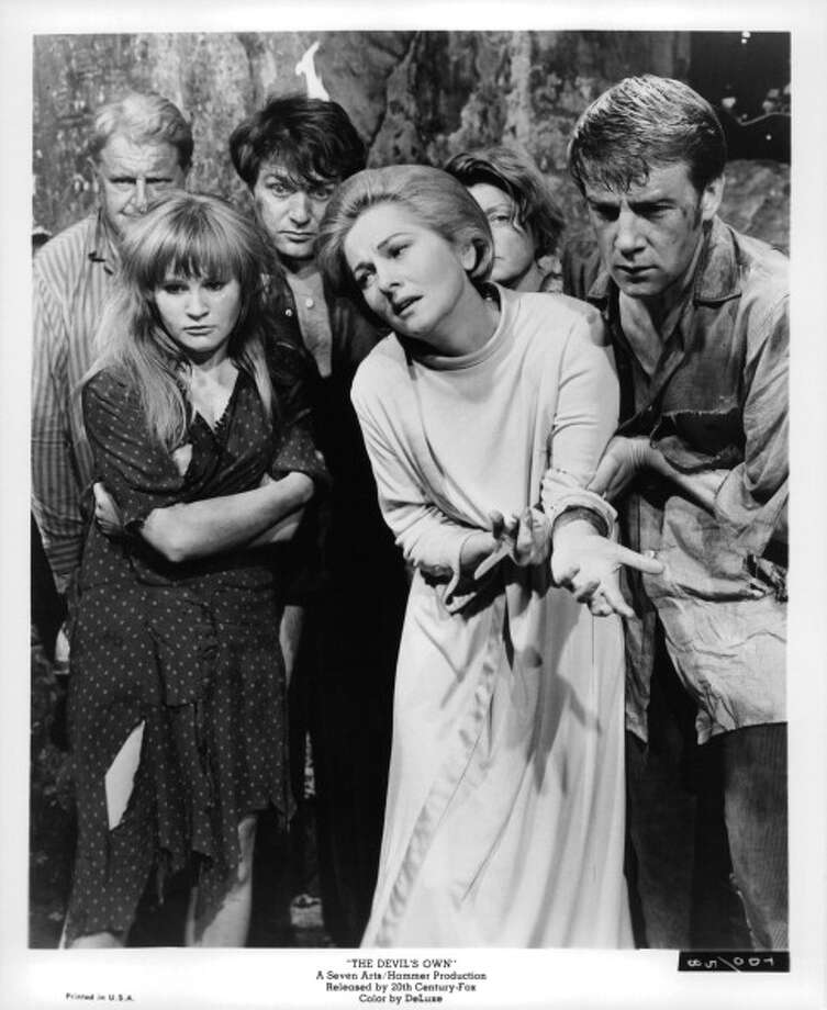 Joan Fontaine suffering among unidentified actors in a scene from the film 'The Devil's Own', 1966. (Photo by 20th Century-Fox/Getty Images) Photo: Michael Ochs Archives, Getty Images / 2011 Getty Images