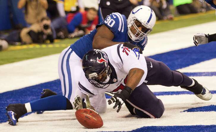 Texans offensive tackle Duane Brown dives in front of Colts defensive end Cory Redding (90) to recover a Case Keenum fumble in the end zone, resulting in a third-quarter safety on Sunday.