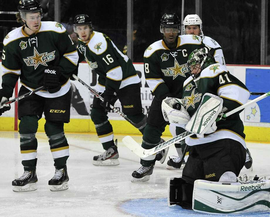 Texas goaltender Cristopher Nilstorp (right) makes a stop while surrounded by his teammates. The Stars earned their 12th win in 15 games against the Rampage. Photo: Darren Abate / For The Express-News / Darren Abate/DA Media, LLC