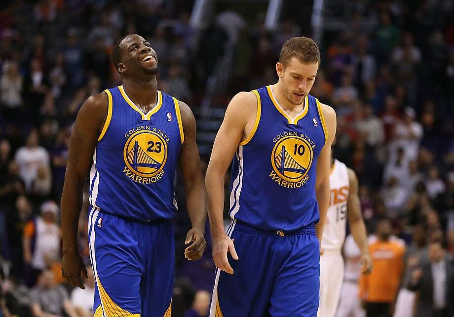 Draymond Green (23) and David Lee show their disappointment in the final seconds of the Warriors' loss, the team's ninth in the past 14 games. Photo: Christian Petersen, Getty Images