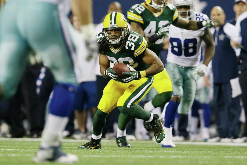 Green Bay Packers cornerback Tramon Williams (38) grabs an interception from Dallas Cowboys quarterb