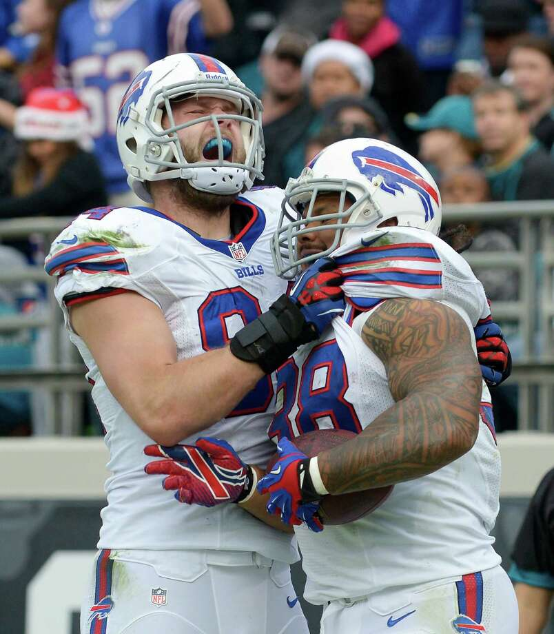 Buffalo Bills tight end Scott Chandler (84) celebrates with fullback Frank Summers, right, after Summers caught a 1-yard touchdown pass against the Jacksonville Jaguars during the second half of an NFL football game in Jacksonville, Fla., Sunday, Dec. 15, 2013.(AP Photo/Phelan M. Ebenhack) ORG XMIT: JVS119 Photo: Phelan M. Ebenhack / FR121174 AP