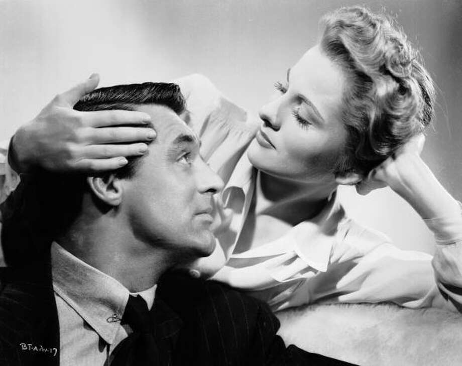 1941:  Joan Fontaine is married to the charming but untrustworthy Cary Grant (1904 - 1986) in 'Suspicion' directed by Alfred Hitchcock.  (Photo via John Kobal Foundation/Getty Images) Photo: John Kobal Foundation, Getty Images / Moviepix