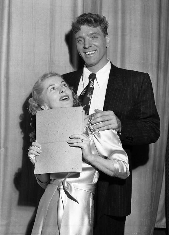 """Actors Joan Fontaine and Burt Lancaster pose for a photograph during rehearsal for their appearance on the CBS program """"LUX RADIO THEATER"""" on February 21, 1949, in Los Angeles, CA.  (Photo by CBS via Getty Images) Photo: CBS Photo Archive, CBS Via Getty Images / 1949 CBS Photo Archive"""