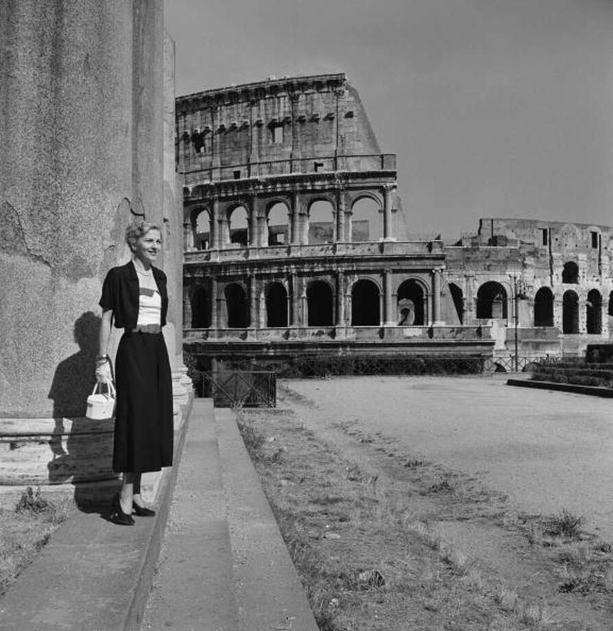 Actress Joan Fontaine poses next to the Colosseum in Rome during the location filming of 'September Affair', August 1949. (Photo by Slim Aarons/Hulton Archive/Getty Images) Photo: Slim Aarons, Getty Images / 2009 Getty Images