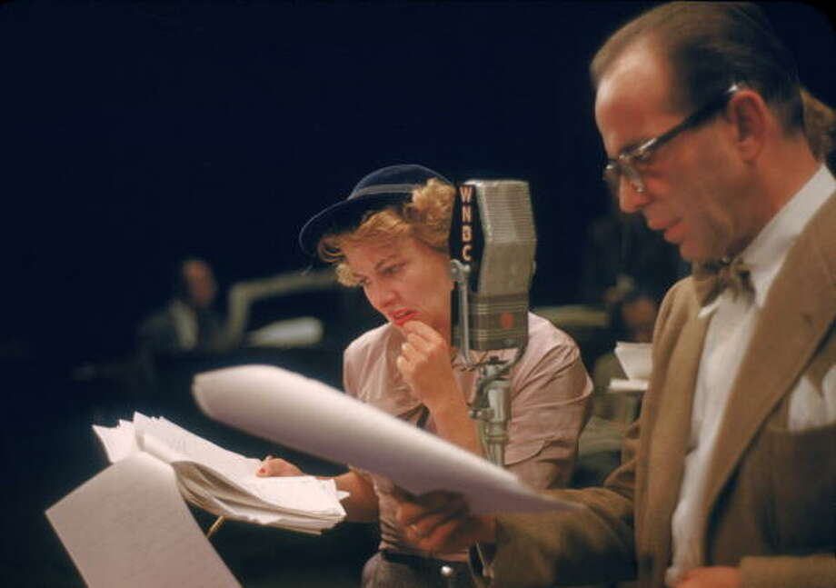 American actors Joan Fontaine  and Humphrey Bogart (1899 - 1957) read from scripts during a radio performance of the Theatre Guild of the Air adaptation of Ernest Hemingway's 'A Farewell to Arms,' New York, New York, October 22, 1950. (Photo by Ruth Orkin/Getty Images) Photo: Ruth Orkin, Getty Images / Premium Archive