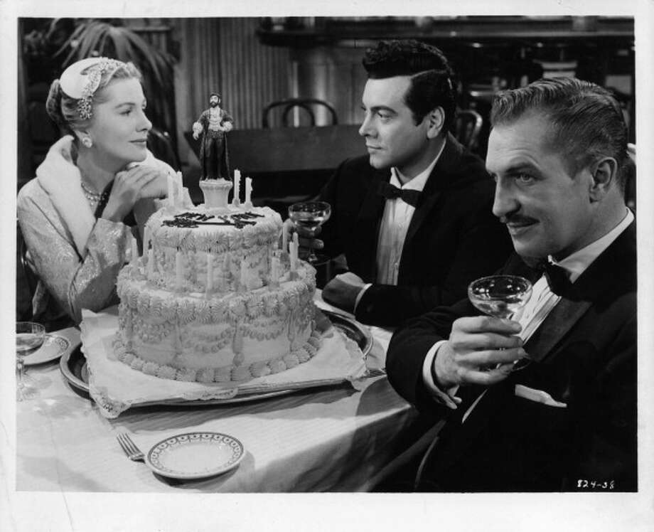 Joan Fontaine sits with Mario Lanza and Vincent Price in a scene from the film 'Serenade', 1956. (Photo by Warner Brothers/Getty Images) Photo: Archive Photos, Getty Images / 2012 Getty Images