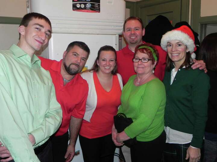 Community Resource Federal Credit Union's employees take a break from serving  100 holiday meals at