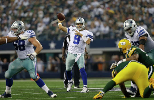 Dallas Cowboys quarterback Tony Romo (9) passes with coverage from the pocket during the first half of an NFL football game against the Green Bay Packers Sunday, Dec. 15, 2013, in Arlington, Texas. (AP Photo/Tim Sharp) Photo: Tim Sharp, Associated Press / FR62992 AP