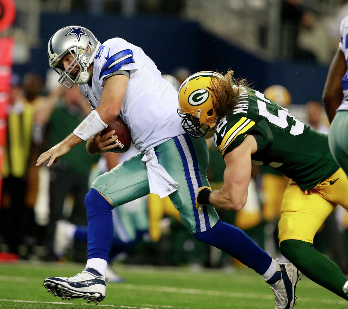 Dallas Cowboys quarterback Tony Romo (9) is sacked by Green Bay Packers inside linebacker Brad Jones (59) during the second half of an NFL football game Sunday, Dec. 15, 2013 in Arlington, Texas. (AP Photo/Waco Tribune Herald/ Jose Yau)