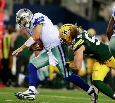 Dallas Cowboys quarterback Tony Romo (9) is sacked by Green Bay Packers inside linebacker Brad Jones (59) during the second half of an NFL football game Sunday, Dec. 15, 2013 in Arlington, Texas. (AP Photo/Waco Tribune Herald/ Jose Yau) Photo: Jose Yau, Associated Press / Waco Tribune Herald