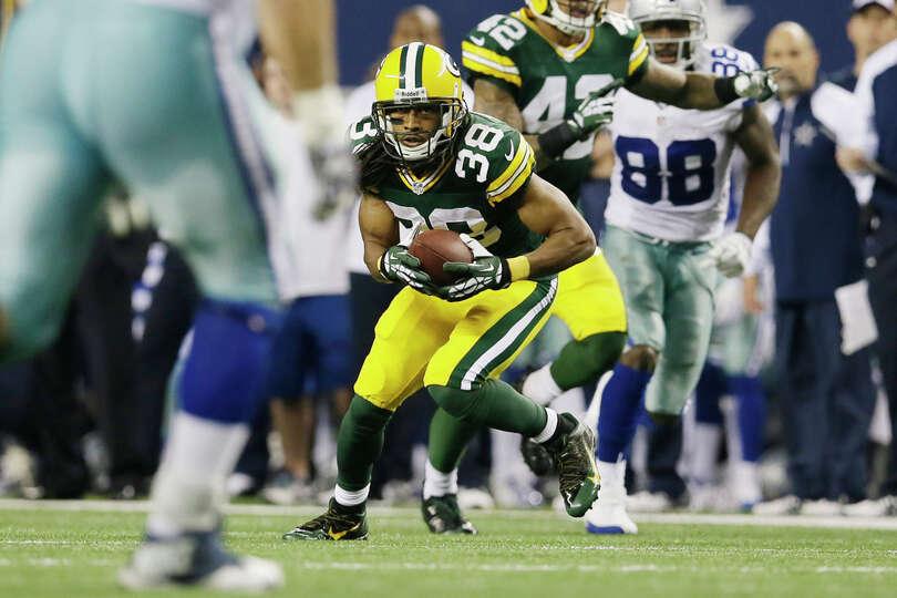 Green Bay Packers cornerback Tramon Williams (38) grabs an interception from Dallas Cowboys quarterb