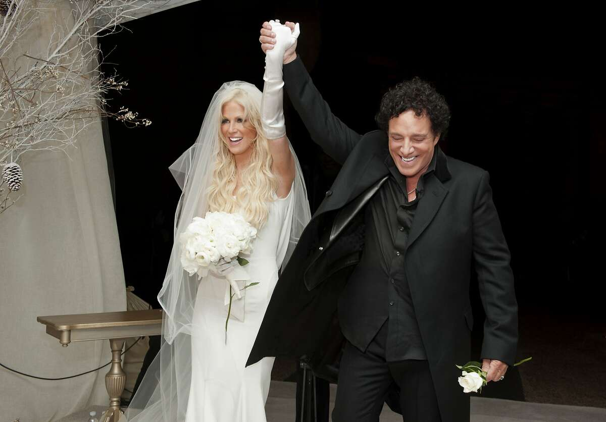 Michaele Schon and Neal Schon immediately after they are pronounced a married couple at their wedding at the Palace of Fine Arts on December 15, 2013 in San Francisco, California.