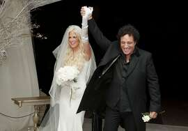 SAN FRANCISCO, CA - DECEMBER 15:  (EXCLUSIVE ACCESS, SPECIAL RATES APPLY) Michaele Schon and Neal Schon immediately after they are pronounced a married couple at their wedding at the Palace of Fine Arts on December 15, 2013 in San Francisco, California.  (Photo by Robert Knight/MNS/WireImage for Schon Productions)