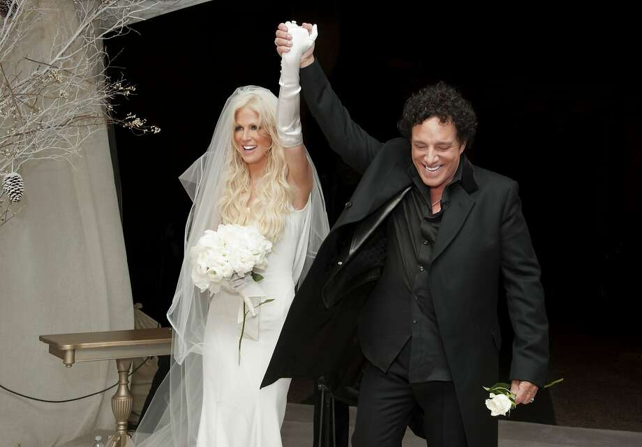 Michaele Schon and Neal Schon immediately after they are pronounced a married couple at their wedding at the Palace of Fine Arts on December 15, 2013 in San Francisco, California. Photo: Robert Knight/MNS, WireImage Via Getty Images