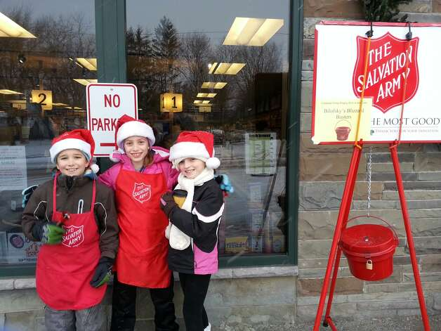 Aless Dagnall-Wise, 10; Emma Anderson, 10; and Ella Moskov, 8, spent time on a frigid Saturday ringing the Salvation Army bell at the Niskayuna Coop. The girls arel members of the of Under-10 Niskayuna Soccer Club. (Photo by Jess Dagnall)
