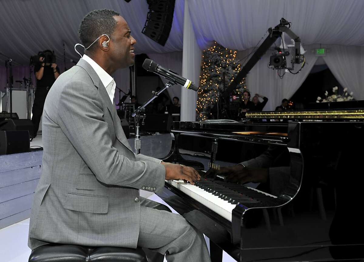 Special guest Brian McKnight performs during the wedding of Michaele Schon and Neal Schon at the Palace of Fine Arts on December 15, 2013 in San Francisco, California.