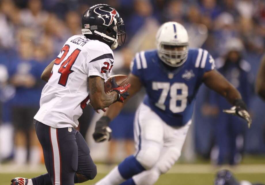 Texans cornerback Johnathan Joseph (24) returns an interception of a pass by Colts quarterback Andrew Luck. Photo: Brett Coomer, Houston Chronicle