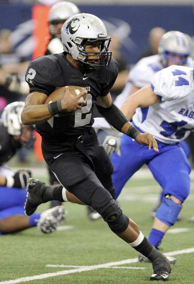 Denton Guyer QB Jerrod Heard led his team to the Class 4A Division I state title over Georgetown last year in Arlington. Guyer also made it to the 5A Division II final in 2010, a loss to Steele. Photo: Matt Strasen / Associated Press / FR170476 AP