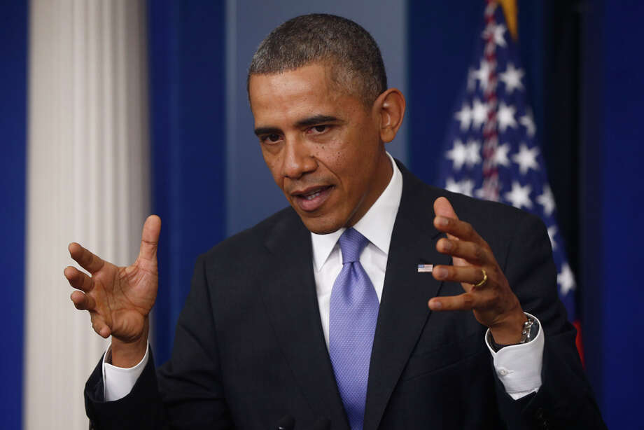 President Barack Obama, news conference, Nov. 14, 2013PHOTO: Obama gestures as he speaks about his signature health care law, Nov. 14, 2013, in the Brady Press Briefing Room of the White House in Washington. Photo: Charles Dharapak, Associated Press / AP
