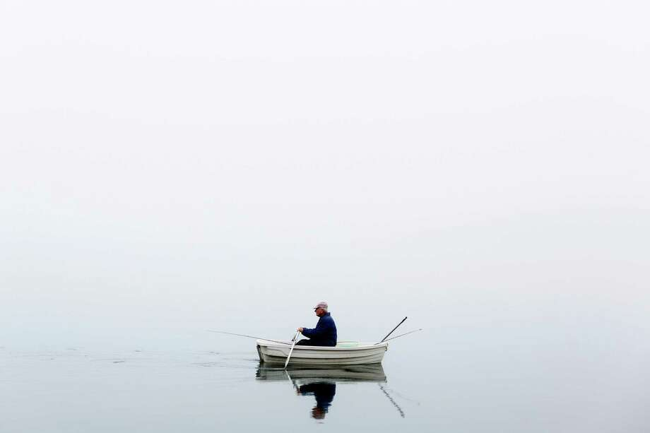 October 24, 2013 — A man rows his way through a fog bank on Green Lake in Seattle. A dry, high pressure system in the region caused the thick, white soup to blanket Seattle for days. Photo: JORDAN STEAD, SEATTLEPI.COM / SEATTLEPI.COM