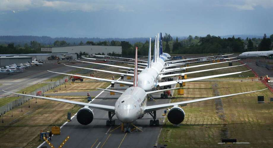 June 18, 2013— A row of Boeing 787 Dreamliners are shown at Paine Field as officials investigate a battery issue with the airplane. This year saw challenges for the airplane manufacturer with battery problems on the 787 and a labor dispute that may see the future 777X line moved away from the Puget Sound region. Photo: JOSHUA TRUJILLO, SEATTLEPI.COM / SEATTLEPI.COM