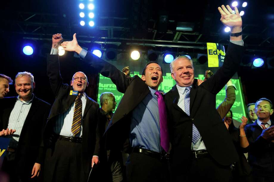 November 5, 2013— Ed Murray, right, and husband Michael Shiosaki, center, wave at supporters from the stage at Murray's election night party at Neumos in Seattle. State Sen. Ed Murray defeated incumbent Seattle Mayor Mike McGinn. Photo: JORDAN STEAD, SEATTLEPI.COM / SEATTLEPI.COM