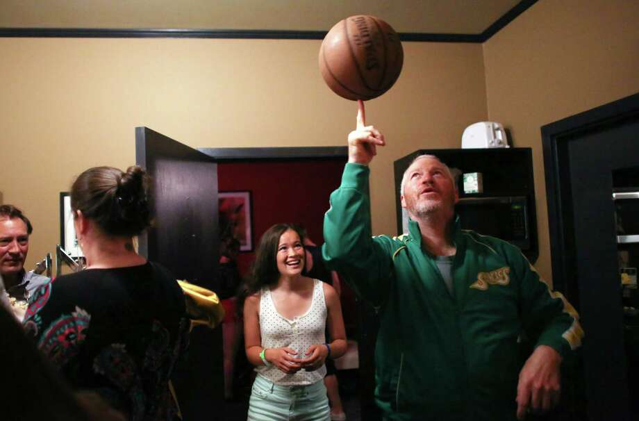 "July 16, 2013 — Seattle Mayor Mike McGinn practices spining a basketball backstage during ""Candidate Survivor,"" a distinctly Seattle twist on local politics. The event featured six of the candidates for Seattle mayor answering questions and audience members voting for them via text messages. During one segment, candidates performed a talent show, getting raucous cheers from hundreds in the audience. Photo: JOSHUA TRUJILLO, SEATTLEPI.COM / SEATTLEPI.COM"