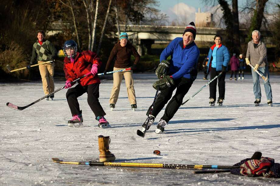 December 8, 2013 — Seattleites enjoy a rare day of ice hockey on the frozen shores of Lake Washington in Seattle's Arboretum as a cold snap takes over the region. Photo: JORDAN STEAD, SEATTLEPI.COM / SEATTLEPI.COM