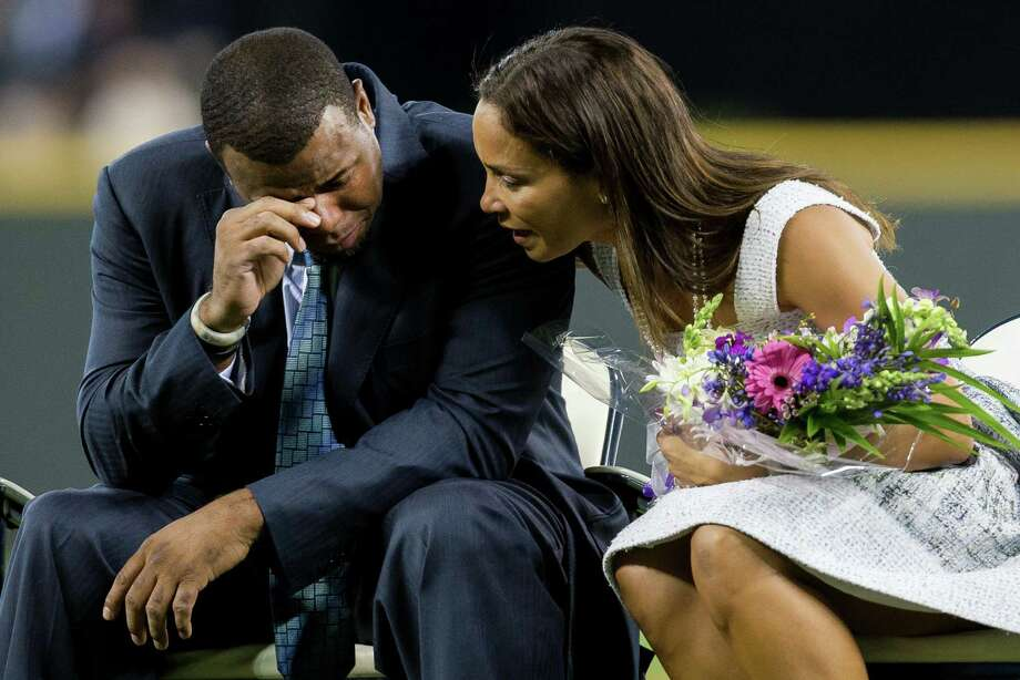 August 10, 2013 — An emotional Ken Griffey, Jr., left, is comforted by his wife, Melissa Griffey, right, after seeing a recorded video of his oldest son broadcast across the Mariners Vision screen during a pregame ceremony serving as his induction into the Mariners Hall of Fame. Griffey, who retired from baseball in 2010, was the seventh member of the team to be inducted. Photo: JORDAN STEAD, SEATTLEPI.COM / SEATTLEPI.COM
