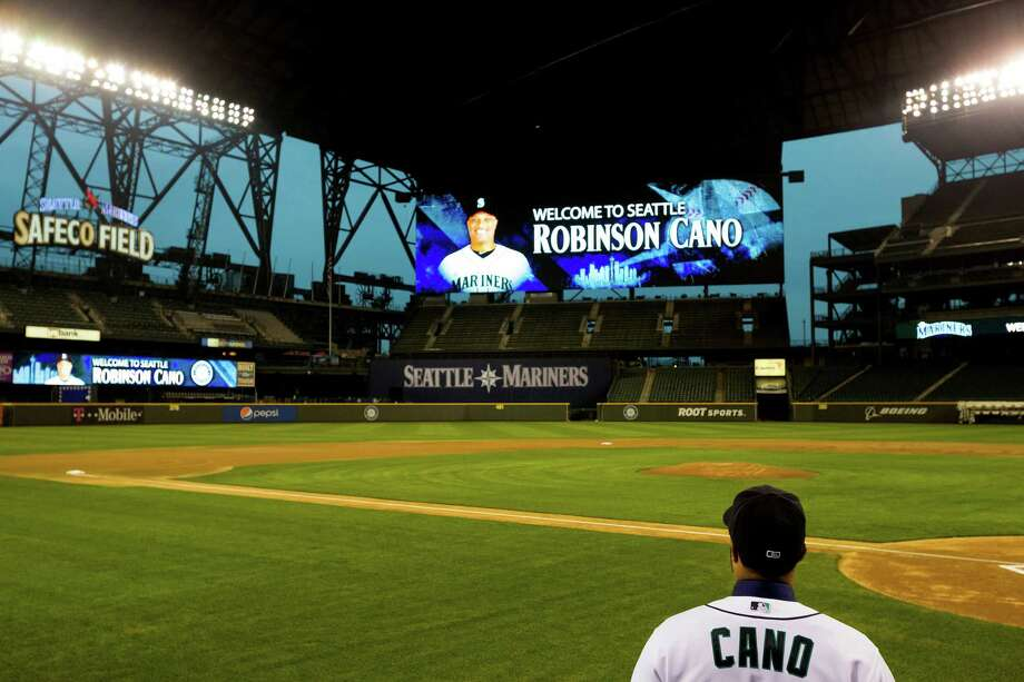 December 12, 2013— New Mariners second baseman Robinson Cano walks onto the field after being introduced to the news media at  Safeco Field. Cano is the biggest free-agent signing in the team's history. Photo: JORDAN STEAD, SEATTLEPI.COM / SEATTLEPI.COM