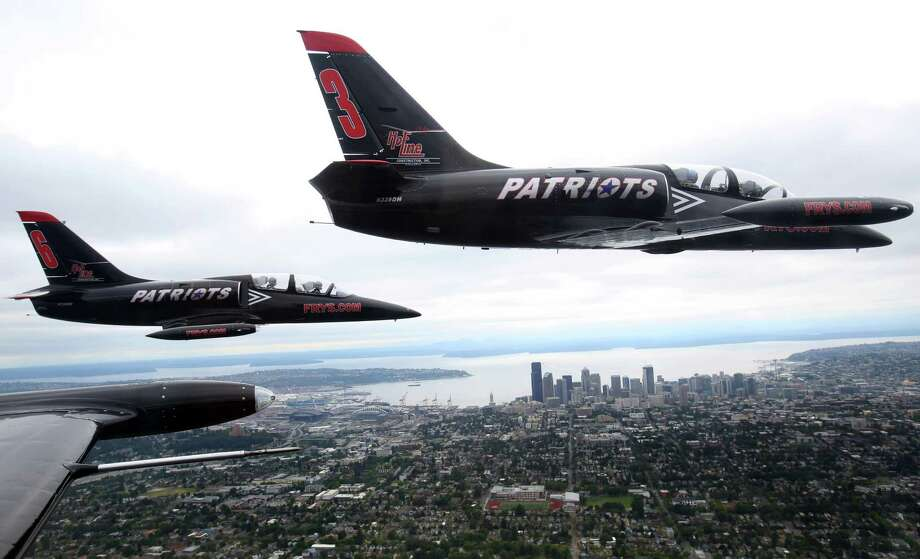 August 1, 2013 — The Patriots aerobatic team performs a formation flight over Seattle in their Czech-built Aero L-39 Albatros aircraft. The team, largely made up of former Navy Blue Angels, Air Force Thunderbirds, and Canadian Snow Bird members, was the main performance at the Seafair Boeing Air Show over Lake Washington after budget cuts forced the Blue Angels to cancel their show. Photo: JOSHUA TRUJILLO, SEATTLEPI.COM / SEATTLEPI.COM