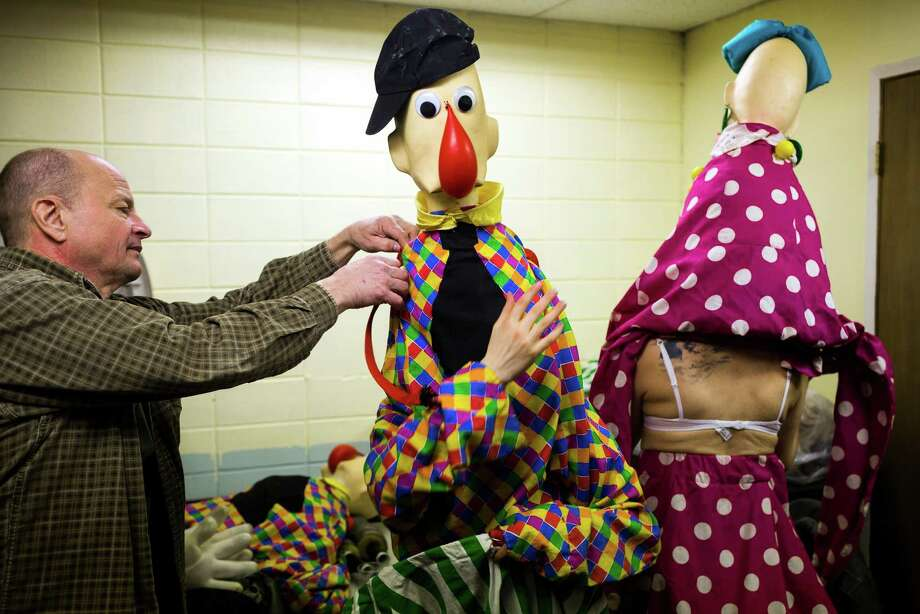 March 21, 2013— Clown Godfrey Daniels, center, gets a hand while suiting up for the opening night of the tenth annual Moisture Festival in Hale's Palladium at Hale's Ales in Seattle. The nearly month-long comedy and variety festival continued until April 14. Photo: JORDAN STEAD, SEATTLEPI.COM / SEATTLEPI.COM