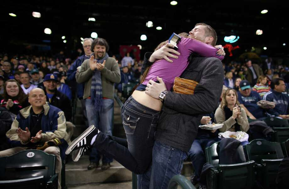 April 8, 2013 — HaleyMae Howells of Tacoma embraces her boyfriend Matt Berzins after he proposed to her during Mariners opening day at Safeco Field in Seattle. Howells said yes to cheers from hundreds of spectators. Photo: JOSHUA TRUJILLO, SEATTLEPI.COM / SEATTLEPI.COM