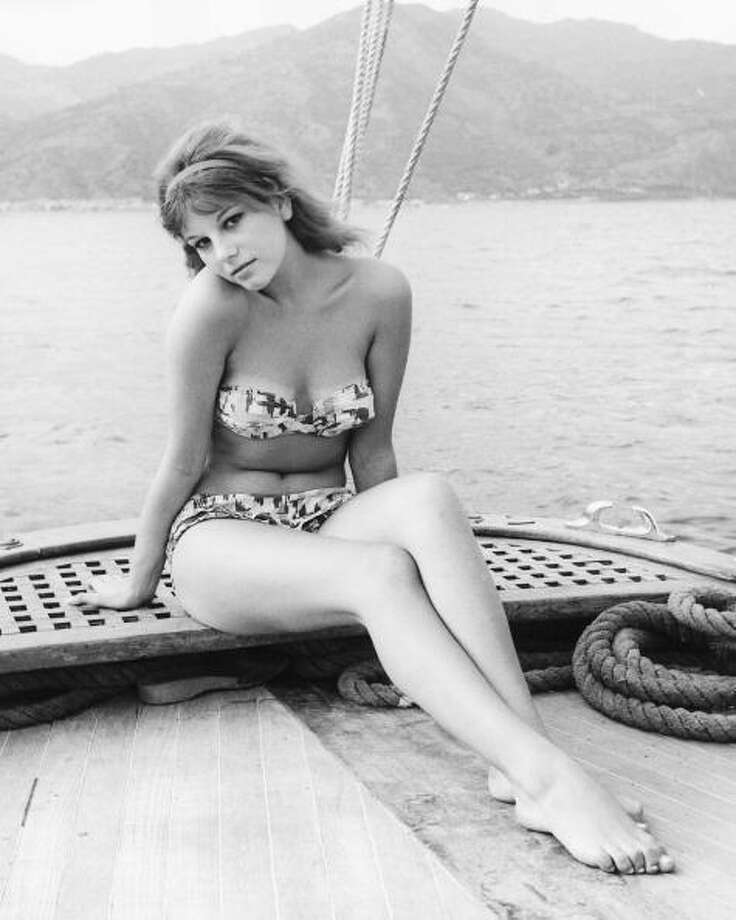 Stefania Sandrelli, Italian actress, wearing a bikini, posing on the deck of a boat, in a publicity portrait issued for the film, 'Divorce Italian Style', 1961. Photo: Silver Screen Collection, Getty Images