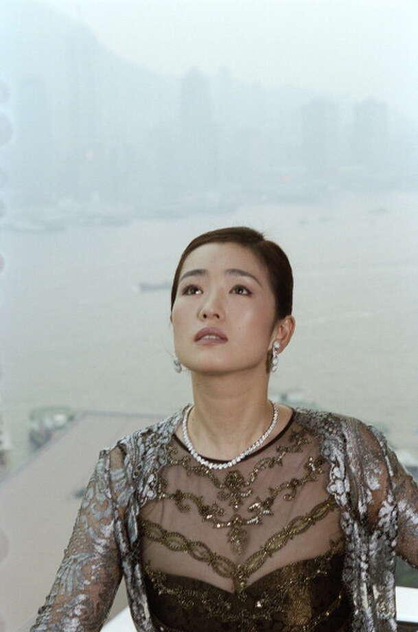 Gong Li, photographed in Paris, circa 1995. Photo: LANGE Jacques, Paris Match Via Getty Images / Paris Match Archive