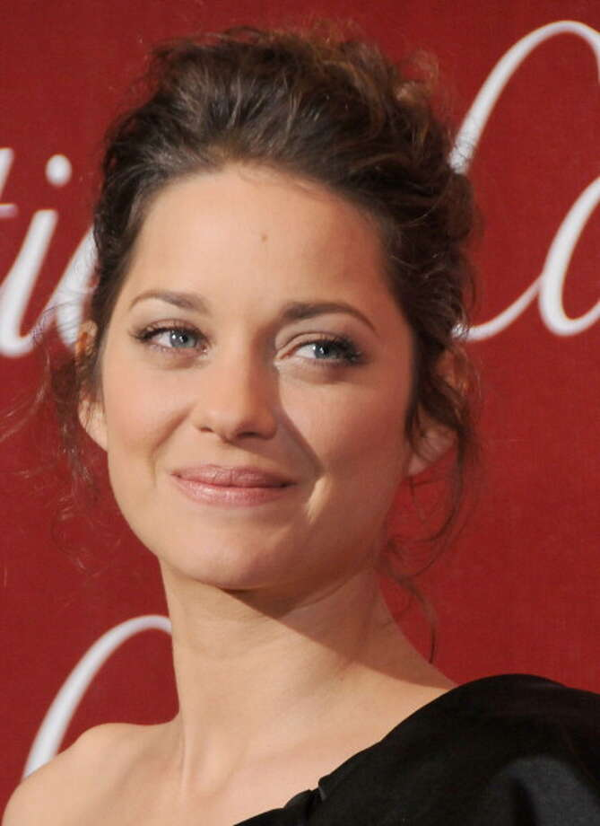 Marion Cotillard arrives at the 2010 Palm Springs International Film Festival Awards Gala at the Palm Springs Convention Center on January 5, 2010 in Palm Springs, California. Photo: Gregg DeGuire, FilmMagic / 2010 Gregg DeGuire