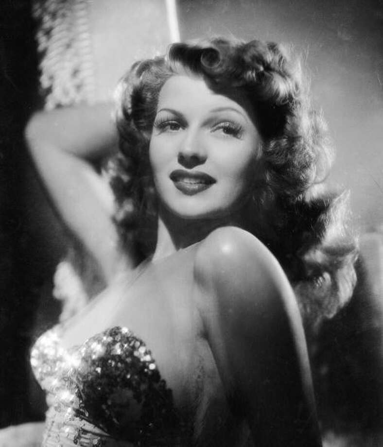American actress Rita Hayworth (1918 -1987), poses seductively to promote the 1942 musical comedy  'You Were Never Lovelier.' Photo: George Hurrell, Getty Images / Moviepix