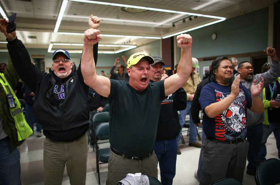 November 13, 2013 — Boeing machinists react as the results of a vote are read at the International Association of Machinists union hall in Seattle. About 30,000 members of IAM District 751 voted with the majority turning down a contract extension that would have cut pension and benefits in exchange for Boeing's commitment to build the 777X in Washington State. Photo: JOSHUA TRUJILLO, SEATTLEPI.COM / SEATTLEPI.COM